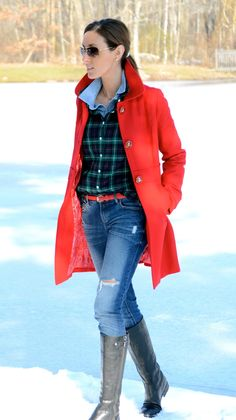 Chambray shirt layered with green/navy plaid shirt, jeans, tan knee boots with green long down coat