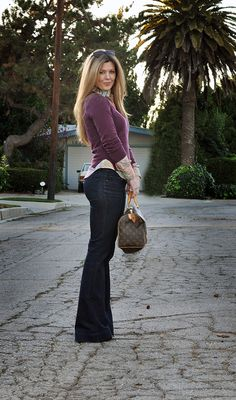 Love everything about this.  Dark flares, button-up under a sweater.  Looks very put-together.
