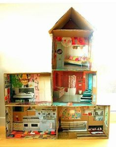 Cardboard Doll House with recycled magazine cut-outs for furniture and accessories. Presented by Choices Family Daycare.