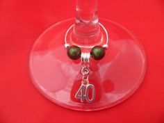 Individual '40th' Wine Glass Charm by Libby's Market Place, http://www.amazon.co.uk/dp/B00BV6JH10/ref=cm_sw_r_pi_awdl_Lg7uvb1XMYJ68