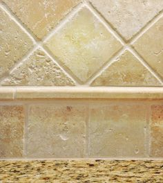 Tile backsplash-this reminds me of the kind of tiles (not the pattern) we had in our former kitchen which we liked.