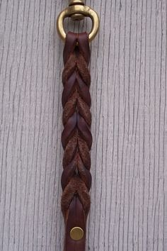A picture tutorial of homemade leather leashes with braided ends. :) | Doberman Chat Forum: Talk About Doberman Pinschers