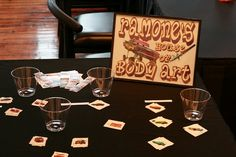 Adorable idea for a Cars themed birthday party.  Ramones House of Body Art - with a selection of Cars tattoos for the kids to put on.