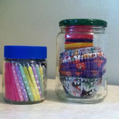 Organizing my cake supplies. Re-use pickle jar to store cupcake papers and re-use bouillon jar for birthday candles. Looks cute too!