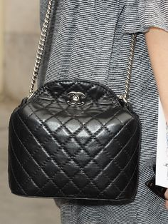 #AlexaChung put a spin on typical #Chanel, carrying the quilted fabric as a bucket bag.