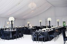 A modern, black & white reception was adorned with romantic drapes. Photography: Kortnee Kate. Read More: http://www.insideweddings.com/weddings/black-and-white-modern-wedding-with-unique-details-in-cincinnati/698/