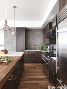 Modern wood kitchen. Design: Robert Bakes and Cecil Baker. Photo: Thomas Loof. housebeautiful.com. #kitchen #modern #kitchen_cabinets #cabinet_pulls