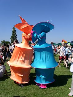 Colourful stilt-walkers by MK Man, via Flickr