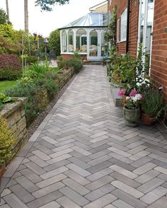 Garden paths are a great way to add character to your outdoor space. This path pattern has been created using Marshalls Alvanley Pavers in silver Sandstone Pavers, Limestone Pavers, Beautiful Flowers Garden, Beautiful Gardens, Tall Plants, Paving Stones, Garden Club, Garden Pests, Trees And Shrubs