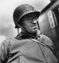 Robert Capa - Normandy. The US General Omar BRADLEY (he has a bandage on his nose and was suffering from a boil).