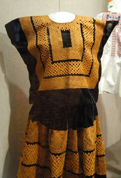 This huipil and skirt costume would be worn by Zapotec women from the Istmo de Tehuantepec in Oaxaca Mexico