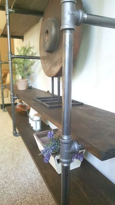 DIY industrial pipe shelves - modern yet rustic vibe