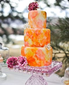 Tartas de boda - Wedding Cake - Pink, orange, yellow watercolor cake with lavender purple square cake stand. Pretty Wedding Cakes, Creative Wedding Cakes, Purple Wedding Cakes, Wedding Cake Photos, Amazing Wedding Cakes, Wedding Cakes With Flowers, Pretty Cakes, Creative Cakes, Amazing Cakes