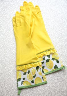 Spring Cleaning Rubber Gloves 14.99 at shopruche.com. Add stylish charm to your kitchen with these yellow latex gloves perfected with satin accents and lemon printed oilcloth cuffs. Complete with loops for hanging.  One size fits most, 100% Rubber gloves, 100% EVA coated cotton cuffs
