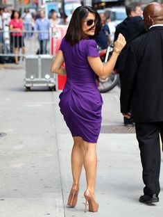 Salma Hayek sexy legs in a purple dress and stilettos