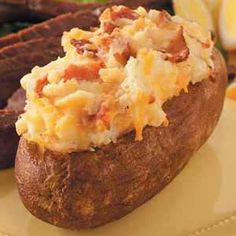 Twice Baked Bake Potato (my adaption)  Ingredients:  6 large baking potatoes  8 tablespoons butter  2 slices of bacon per potato  1 medium onion, chopped  1/4 Cup Milk  1/4 Cup Cream  1 egg  1/2 teaspoon salt  1 cup cheddar cheese (Added to Recipe Book)