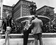 The lost fountain at Pershing Square, designed by Johan Caspar Lachne Gruenfeld, was a social spot until 1952, when the park was gutted to make room for an underground parking garage. During the park's renovation, the 1910 fountain was removed, and no one seems to know what happened to it. This photo, with the Biltmore Hotel in the background, was taken in 1948. (LAPL 00039787) Bizarre Los Angeles