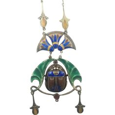 A Sterling Silver Egyptian revival Scarab Necklace is bold and dramatic. It is Arts and Crafts which is highly collected jewelry Era. The large scarab