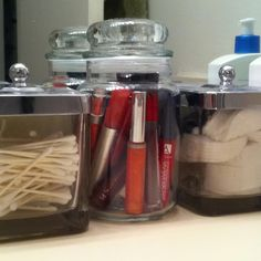 The perfect use for my used Yankee candle jar. Now I have a place to store my growing lipstick/ gloss collection.
