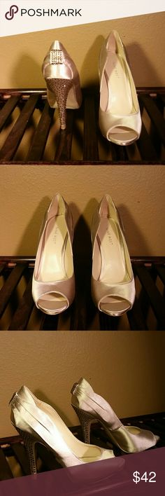 Peep toe pumps Champagne colored peep toe satin pumps with studded 4 inch heels. Worn once as my wedding shoes. Looked perfect. In great condition. Nine West Shoes Heels