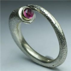 Elegant Silver And Pink Tourmaline Ring - Tribal Jewelry - Ethnic Jewelry - Gemstone Jewelry - Native American Jewelry - Indian Jewelry  Item Details       (1,781)   Shipping & Policies A super shik and elegant handmade solid silver ring.   The stone is tourmaline and set with 18 karat gold. $75