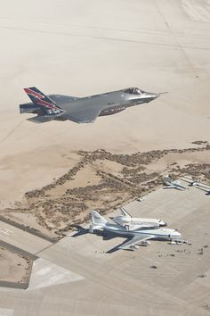 f-35 lightning flying over endeavour, mated to shuttle transport aircraft