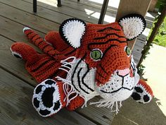 Maximus the Tiger is the 4th Zoo Critter Blankie. He features all the best tiger characteristics designed to be made from common materials and simple stitches. Pattern is very detailed and arranged for ease of reading and following.