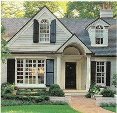 Love the painted brick, black shutters & door, and the portico!