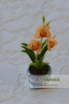 A Small Handcrafted Orange Cymbidium Orchid by ClayOrchids on Etsy, $6.50