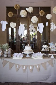 Clothesline with baby clothes as decorations. Double duty!