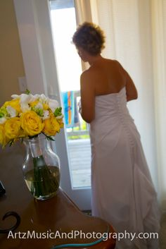 Stacie looking out of the window, just before she marries her groom in Hatteras, NC
