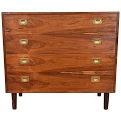 View this item and discover similar for sale at - This Danish midcentury chest features four stacked drawers, adorned with brass hardware. It has the stunning color and grain characteristic of rosewood. Hallway Furniture, Chest Of Drawers, Apartment Living, Danish, Mid-century Modern, Mid Century, Storage, Home Decor, Dresser