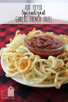 Heaping plate of Air Fryer Spiralized Garlic French Fries on a red plaid tablecloth Garlic French Fries, Spiral Potato, Air Fryer French Fries, Air Fryer Oven Recipes, Spiralizer Recipes, Zoodle Recipes, Salmon Recipes, Clean Eating Snacks, Healthy Recipes