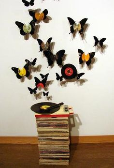 vinil discs turn into butterflies
