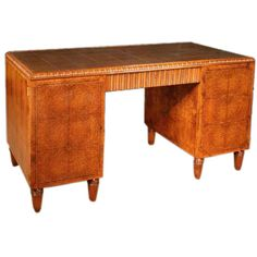 """French Art Deco Amboyna pedestal desk (writing library table), attributed to Paul Follot. CIRCA: 1930 DIMENSIONS: 30"""" h x 55"""" w x 27"""" d"""