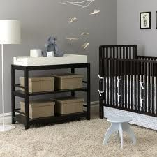 Grey Nursery - I like the idea of grey walls for her nursery. Purple accents.