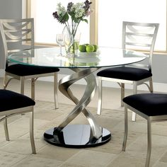 Bring modern sculpture designs to the dining room with this elegant and swirling round table. The base is steadily balanced upon twisting legs that emanate modern sculptures, while supporting an expansive glass top for drinks and snacks.