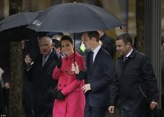 People's princess: Kate smiled and waved as she greeted fans who stood outside in the pouring rain just to get a glimpse of her