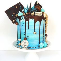 Blue frosting with dark chocolate drip cake.