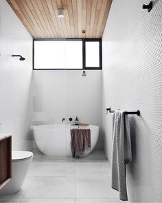 Small bathroom timber cladding Got a small space to work with? Here are our top tips for maximising your bathroom space: Bad Inspiration, Bathroom Inspiration, Interior Bauhaus, Cozy Bathroom, Large Tile Bathroom, Bathroom Ideas, Small Bathroom With Bath, Parisian Bathroom, Bathroom Canvas