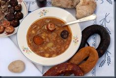 It´s called Stone Soup  .  The name comes from a portuguese legend , witch tells us about a monk who had nothing to eat .  So , one day , he put a stone in a pot a begged for something to join it , so he could make a soup .  At the end of the day he had the pot full of many good things   The stone soup has everything : potatoes , beans , carrots ,oignons , porc meat , sausage ,cabbage ....  It´s very good , but if you eat one soup plate of it , you´r not able to eat anything else