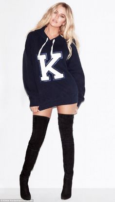 Hot:In an Instagram snap, the blonde Keeping Up With The Kardashian star modeled the top - with a K on the front, of course - while adding kinky boots