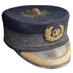 This classic C19th design of the Great Western Railway's Station Master's cap continued in use until the end of 1947 when the railways were nationlised.  The only clue that this hat does not date from the 1890s is the 1930s art deco style GWR monogram on the badge.