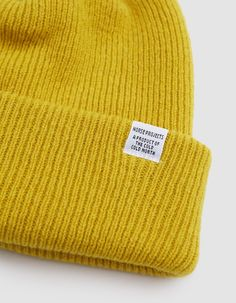 Classic beanie from Norse Projects. Available in Navy, Light Grey, Charcoal, White, Sulfur or Moss. Rib knit. Cuffed design with contrast logo tag. • 7 gg knit • 100% lambswool • Hand wash cold, dry flat • Made in Portugal