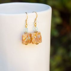Harvest Earrings $15, perfect fall companion with the pumpkin orange and pale blue