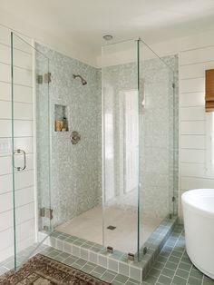 corner seamless shower; blue-gray tiles