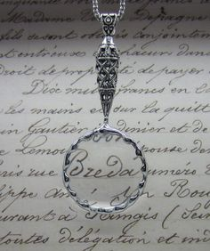 Beautiful magnifying glass necklace!