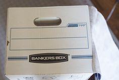 Make Stylish Storage Bins By Covering Bankers Boxes with Fabric Fabric Storage Boxes, Storage Bins, Diy Design, Dollar Store Bins, Barn Door Console, Cardboard Organizer, Diy Gift Box, Old Boxes, Cardboard Crafts