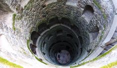 A thread of mysteries: The initiatic well of Sintra inthe complex of Quinta da Regaleira built in cent in the ancient Sintra historical site. Historical Sites, Architecture, Building, Arquitetura, Buildings, Construction, Architecture Design, Architectural Engineering