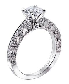 CascadeShimmering round diamonds line the tapered band of this elegant ring setting for her. One-eighth carat total weight. Fashioned in 14K white gold. Center diamond sold separately. Exclusively available at Jared® the Galleria of Jewelry.